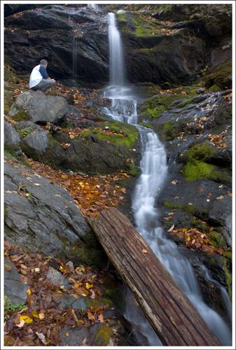 Adam perches on a rock along lower Doyles River Falls.