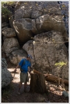 Adam Walking by Giant Boulders